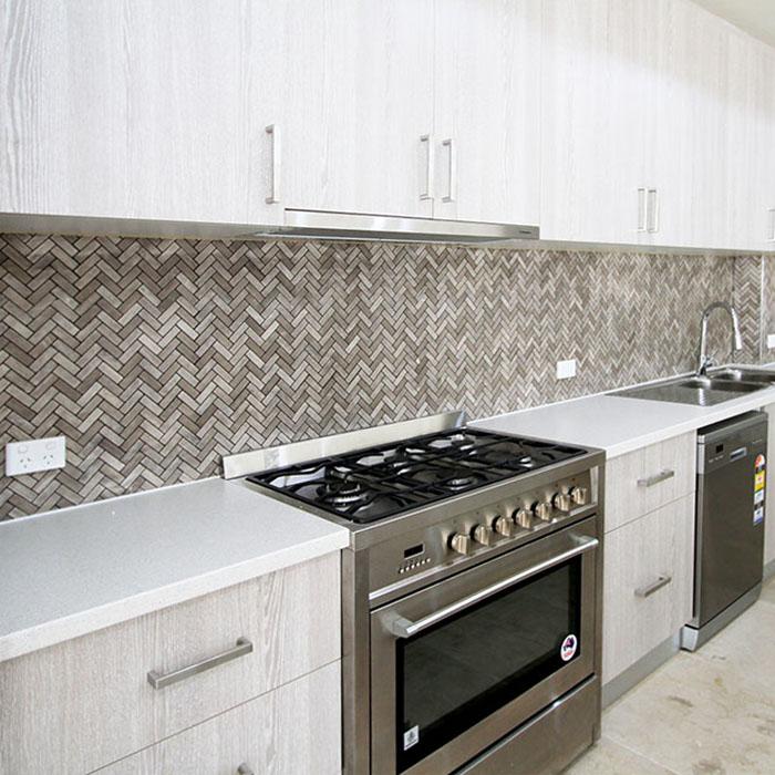 Serpeggiante Herringbone Limestone Mosaic Tile